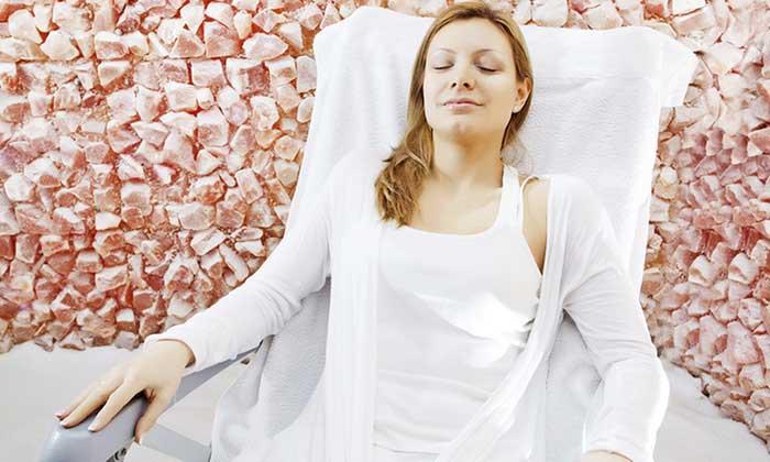 Woman sittin in a salt room